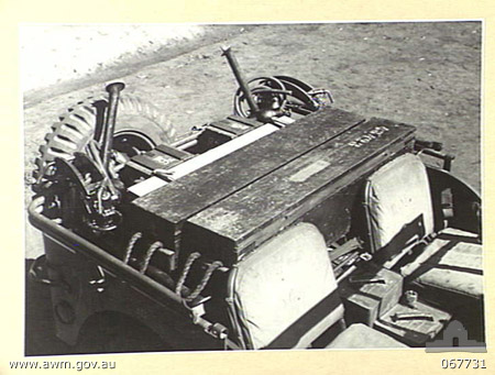 HERBERTON, QUEENSLAND, AUSTRALIA. 1944-07-25. A JEEP LOADED WITH FULL GUN EQUIPMENT. THIS LOADING METHOD WAS EVOLVED BY PERSONNEL OF THE 2/3RD MACHINE GUN BATTALION AND IS EXPECTED TO BE ADOPTED BY THE AUSTRALIAN ARMY.