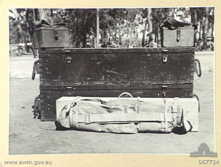 HERBERTON, QUEENSLAND, AUSTRALIA. 1944-07-25. VICKERS GUNS AND SPARE PARTS WHICH COMPRISE THE TOP LAYER OF THE LOAD OF COMPLETE MACHINE GUN EQUIPMENT. THIS LOADING METHOD WAS EVOLVED BY PERSONNEL OF THE 2/3RD MACHINE GUN BATTALION AND IS EXPECTED TO BE ADOPTED BY THE AUSTRALIAN ARMY.