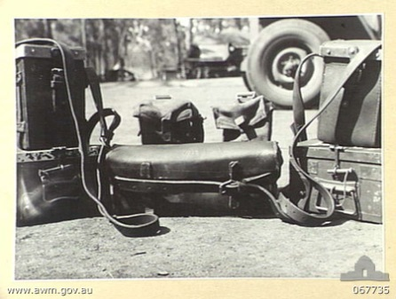HERBERTON, QUEENSLAND, AUSTRALIA. 1944-07-25. SMALL COMPONENTS OF THE MACHINE GUN EQUIPMENT WHICH ARE PORTION OF THE COMPLETE EQUIPMENT OF MACHINE GUNS TO BE LOADED ON TO A JEEP USING A NEW TECHNIQUE EVOLVED BY PERSONNEL OF THE 2/3RD MACHINE GUN BATTALION.