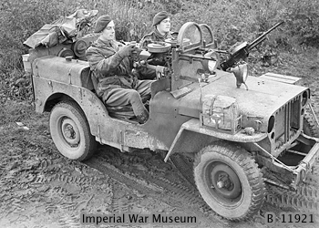 WAR OFFICE SECOND WORLD WAR OFFICIAL COLLECTION THE SPECIAL AIR SERVICE (SAS) DURING THE SECOND WORLD WAR A jeep manned by Sergeant A Schofield and Trooper O Jeavons of 1 SAS near Geilenkirchen in Germany. The jeep is armed with three Vickers 'K' guns, and fitted with armoured glass shields in place of a windscreen. The SAS were involved at this time in clearing snipers in the 43rd Wessex Division area.