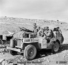 WAR OFFICE SECOND WORLD WAR OFFICIAL COLLECTION THE SPECIAL AIR SERVICE (SAS) IN NORTH AFRICA DURING THE SECOND WORLD WAR Two members of 1 SAS , Captain D C Mather MC, Welsh Guards and Captain G Alston, Royal Artillery (nearest camera) in a heavily loaded jeep.