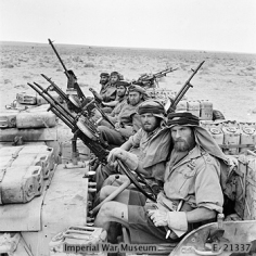 WAR OFFICE SECOND WORLD WAR OFFICIAL COLLECTION THE SPECIAL AIR SERVICE (SAS) IN NORTH AFRICA DURING THE SECOND WORLD WAR A close-up of a heavily armed patrol of 'L' Detachment SAS in their jeeps, just back from a three month patrol. The crews of the jeeps are all wearing 'Arab-style' headdress, as copied from the Long Range Desert Group.