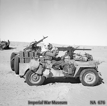 WAR OFFICE SECOND WORLD WAR OFFICIAL COLLECTION THE SPECIAL AIR SERVICE (SAS) IN NORTH AFRICA DURING THE SECOND WORLD WAR An SAS jeep in the Gabes-Tozeur area of Tunisia. The vehicle is heavily loaded with jerricans of fuel and water, and personal kit. The 'gunner' is manning the .50 inch Browning heavy machine gun, while the driver has a single Vickers 'K' gun in front, and a twin mounting behind.