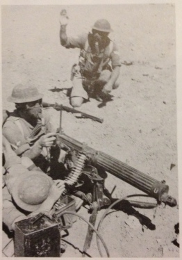 Vickers machine-gun crew practise under simulated gas attack conditions - Egypt 1936