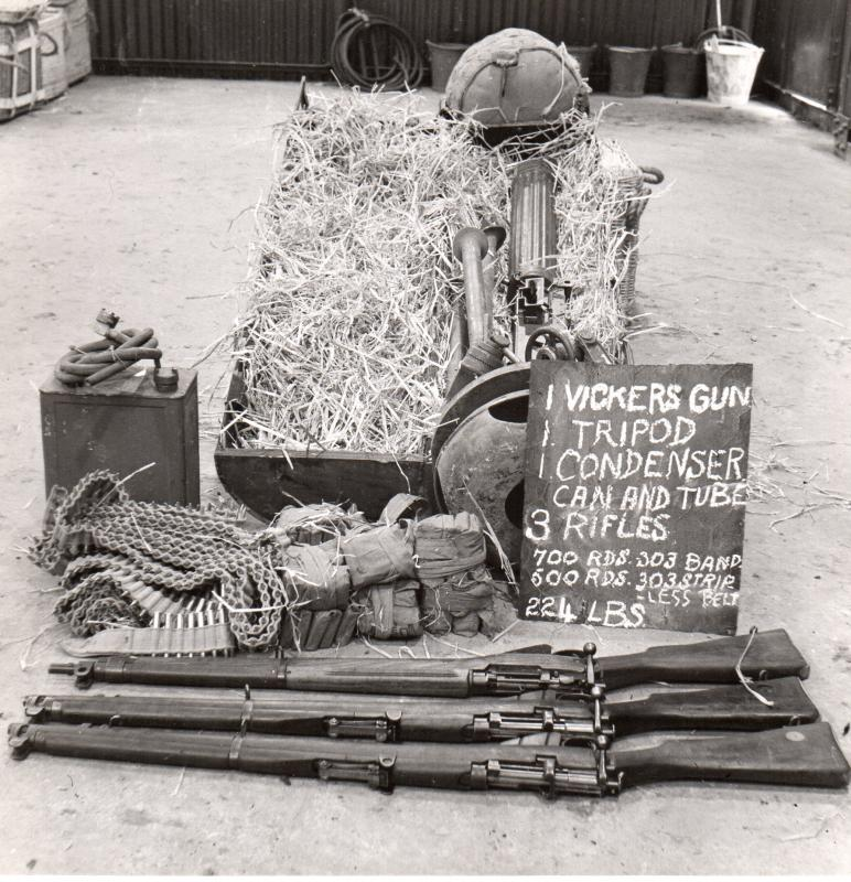 CLE CONTAINING VARIOUS WEAPONRY AND AMMUNITION, INCLUDING VICKERS GUN AND TRIPOD